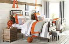 Gray and Orange bedroom with planking wall