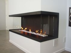Google Image Result for http://static.designlike.com/wp-content/uploads/2011/11/Modern-and-traditional-fireplaces-by-Warmington-Fires-6.jpg