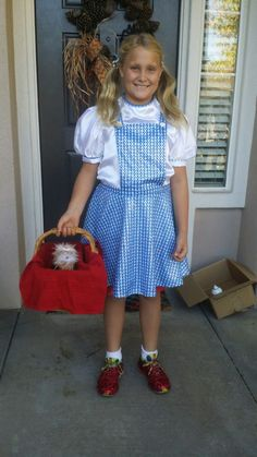 DIY Halloween Costume in under 40 minutes flat. Here's how I made a Dorothy Live Literature Day #costume using a hand me down, reeboks, spray adhesive, and red glitter. #GameofWife #Halloween #DIYCostume #LastMinuteCostume #Win #SitsBlogging