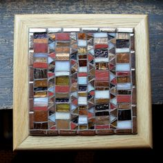 Shades copper, brown, and off-white combine in Italian iridized glass, stained glass, metallic glass tile, and copper smalti to create a mosaic