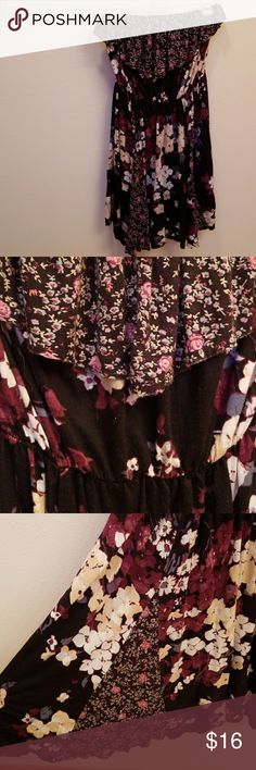 Urban Outfitters strapless dress From Urban Outfitters, a cute floral-patterned strapless dress with fun use of different patterns, both with a loose ruffle flap along the top, and triangle cut outs at the bottom. Elastic top and waist band still very much in good shape and hold the dress up nicely. Excellent condition. Urban Outfitters Dresses Mini