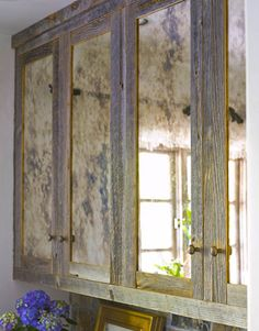 Love the juxtaposition of the matt wood trim and the shine of the mirrors Mirror Cabinets, Diy Cabinets, Cabinet Doors, Whitewash Cabinets, Glass Cabinets, Bathroom Cabinets, Rustic Kitchen Cabinets, Kitchen Refacing, Rustic Kitchens