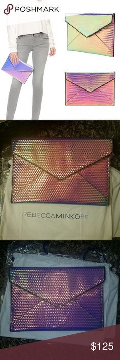 "Rebecca Minkoff Iridescent Clutch  🦄 Firm Price Brand New with Linen Dust Bag. Iridescent Effect Clutch from Rebecca Minkoff. It reminds me of Unicorns 🦄. Perfect for Summer. Features a magnetic snap flap closure and fully lined with six card 💳 slots inside.  Measures 10.75""W x 7.5""H x 1""D Rebecca Minkoff Bags Clutches & Wristlets"