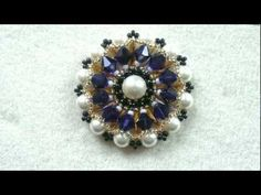 Beading4perfectionists : Wheel pendant with 6mm Swarovki pearls and bicones beading tutorial