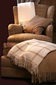 Picture of an armchair with throws and cushions