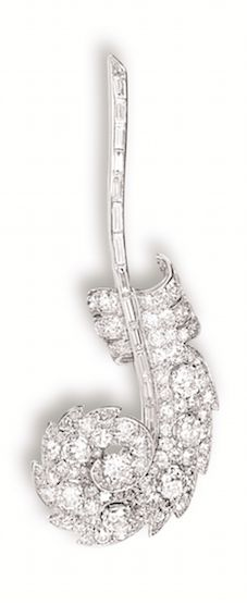 DIAMOND 'FEATHER' BROOCH, MOUNTED BY CARTIER, CIRCA 1930 Modelled as a feather, set with old-cut and baguette diamonds together weighing approximately 10.00 carats, mounted in 18 karat white gold, signed Monture Cartier.