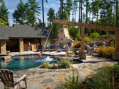 Looking for a fun pool feature other than a diving board or slide? Adding a pool rope swing is a growing trend in swimming pool design. ideas with slide and diving board Backyard Pool Designs, Swimming Pools Backyard, Swimming Pool Designs, Pool Landscaping, Backyard Patio, Piscina Spa, Diving Board, Rope Swing, Outdoor Retreat