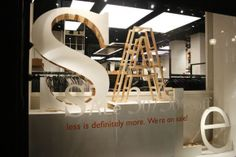 Different sizes, different textures of wood, really nice. Window Display Design, Store Window Displays, Retail Windows, Store Windows, Light Bulb Letters, Store Layout, Retail Merchandising, For Sale Sign, Retail Design