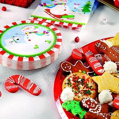 Colorful snowman plates complement a mixed platter of holiday cookies. Click for more ideas and host a Christmas cookie exchange party this year!