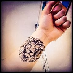Arm tattoo of a lion face. Leo tattoos art