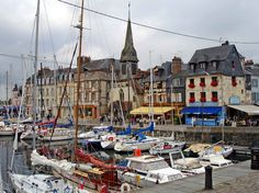Honfleur, France. Lots of water, and pretty boats - I like it!