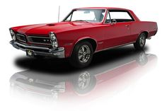 1965 Montero Red Pontiac GTO 389 Tri-Power 4 Speed Muscle Car. Photo Credit: RK Motors Charlotte.