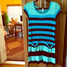 Kensie dress Kensie dress is so incredibly soft!!! I have a thing for soft clothes and this is the softest! Hits in all the right places And doesn't cling! Great colors and perfect for spring and summer! Like new. Perfect condition. 100% viscose. Kensie Dresses