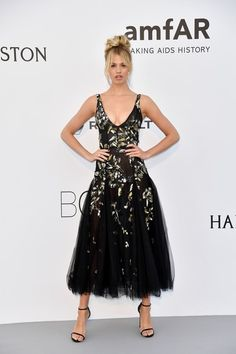 US model Hailey Clauson poses as she arrives for the amfAR's 24th Cinema Against AIDS Gala on May 25, 2017 at the Hotel du Cap-Eden-Roc in Cap d'Antibes, France. / AFP PHOTO / ALBERTO PIZZOLI
