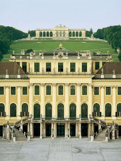 Schonbrunn Palace and Park - The central section of the palace showing the perron leading up to the Great Gallery, with the Gloriette in the background. Of the 1,441 rooms in the palace 39 on the first floor can be seen by visitors participating in guided tours. The palace also boasts a fine selection of royal coaches