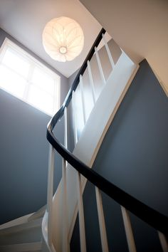 Edith's Clean & Colorful Oslo Townhome - painting stair rails and border white