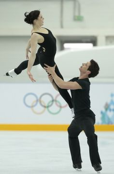 Canada's Tessa Virtue and Scott Moir skate at the figure skating practice rink ahead of the 2014 Winter Olympics, Wednesday, Feb. 5, 2014, i...