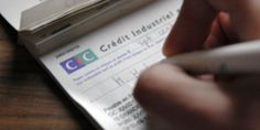 Les députés réduisent la validité des chèques de un an à six mois