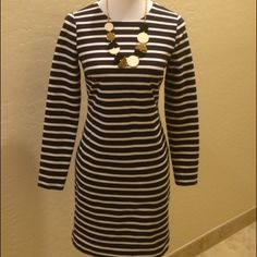 """MICHAEL Michael Kors Black & White Striped Dress MICHAEL Michael Kors BRAND NEW Without Tags Black & White Striped Long Sleeve Dress!  Chic Year Round Dress made  Poly / Rayon /Spandex/  Lycra. Gorgeous detail with an oversized back zipper& completely lined!  Looks great with Statement piece of jewelry or pair it with a Jacket Measures 35"""" Length/ Bust 16"""" Flat  ( MICHAEL Michael Kors Dresses Long Sleeve"""