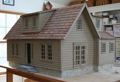Love this custom 1:12 scale dollhouse. Notice the trim, windows and clapboard are all the same soft colonial color. Sometimes simple is better! Rick Maccione-Dollhouse Builder www.dollhousemansions.com