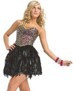 Party Time 6855 Black Short Homecoming Dress Fly away in this stunning feathered cocktail mini dress by Party Time Formals. The bodice is adorned with stunning multi-colored bead work and the skirt is fully colored with rich dark feathers. Perfect for prom, homecoming and cocktail events, this style is bound to make a statement that won't soon be forgotten.