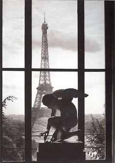 Angel overlooking Eiffel Tower by Willy Ronis