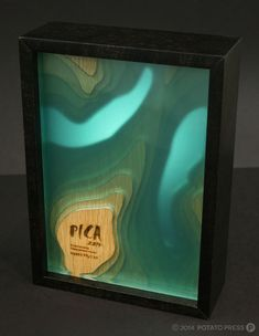 laser cut, wood plus acrylic.... layers