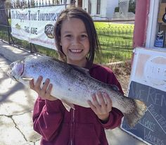 ALL SMILES RAINBOW — Layla Godfrey, 9, from Oakdale had a good day at Bridgeport Reservoir, bringing in this 6-pound, 4-ounce football using PowerBait. Trolling for perch has also been producing good numbers of fish.