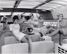 flight attendants aboard the lockheed L-1011 tri-star, wearing fabulous outfits, and happy about it all.