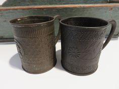 Ebay: Pair of antique embossed tin cups.