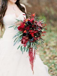 Rustic marsala winter wedding bouquet: http://www.stylemepretty.com/wisconsin-weddings/wausau-wisconsin/2016/01/20/northwoods-elegant-marsala-wedding-inspiration/ | Photography: Natashia Nicole - http://natashianicolephotography.com/