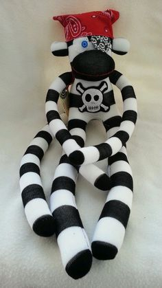 Pirate Sock Monkey with Custom Monogram. I think I would make traditional monkey with scarf, patch, skull.