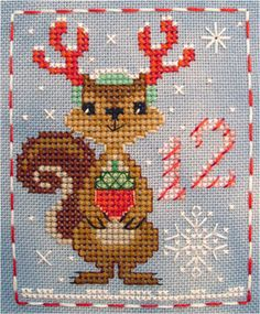 #12 Sophie Squirrel of the Brooke's Books Advent Animals Freebies Cross Stitch Collection by Brooke Nolan. http://www.craftsy.com/user/1333992/pattern-store?_ct=fhevybu-ikrdql-fqjjuhdijehu