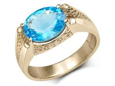 Natural oval blue topaz set on V shaped shoulders with cheetah gold design Stone weight: Stone size: mmGold: 10 karat Stone Weight, Blue Topaz Ring, Diamond Wedding Bands, Black Diamond, Cheetah, Gemstone Rings, Rings For Men, Natural, Modern