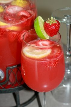 Strawberry Limeade Rum Punch (2 liter ginger ale, 12 oz frozen limeade, 10 oz frozen Bacardi strawberry Daiquiri Mix, 2½ cups rum lemon, lime and strawberries)