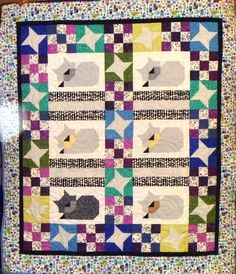 Meow! Another quilt with the tailor's scrappy kitty cats.
