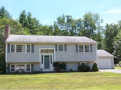 OFF THE MARKET TEMPORARILY - Merrimack, NH - Updated kitchen, 3 spacious bedrooms, finished basement and large attached garage. Large lot with lots of privacy. Don't delay...won't last long.