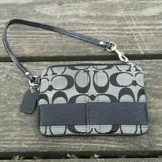 Coach black and light gray wristlet! Black and light gray wristlet! No card slots on the inside. EUC. Coach Bags Clutches & Wristlets