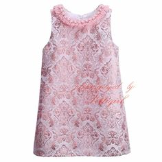 We love this sweet toddler dress. It has a soft pearl outline around the collar with a hint of fringe. Perfect for a special occasion. Comes inan adorable bl