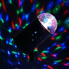 Rotating LED Crystal Mini Disco Ball Stage Spot Light |  Add loads of fun and exciting colors to your dreary party space or event venue with these flashy cylinder shape crystal magic mini spotlights that exude streaks of glitzy lights in wonderfully vibrant tones. The dome shaped top creates stunning lighting design, while the counterclockwise rotation flashes striking gleams of colorful lights all around; on walls, ceiling and floor. Enjoy getting peppy and groovy on your party night with…