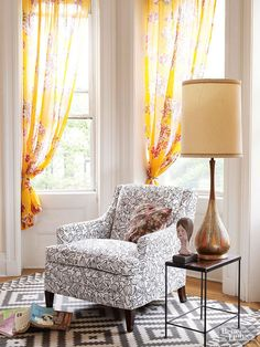 A bedroom sitting area includes an upholstered chair, found for a whopping $20, which was re-covered. The wood statue and teardrop-shape lamp were thrift and antiques store finds.