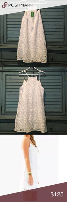 "Lilly Pulitzer Eyelet Delray Diamond Dress Lilly Pulitzer Dusk Strappy Lace Slip Dress Color:resort white  Knit lace strappy swing dress with tassels. 18 1/2 "" from natural waist to hem. Fully lined. Polyester. Style: 20081 115MY4 Easy care, perfect for travel. Will not wrinkle. Total length is 36 inches with adjustable spaghetti straps. Excellent for tropical wear or cruise. It can be worn by itself or with different color shrug, jacket or scarf. Brand new with tag.  L: armpit to armpit…"