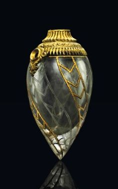 A ROCK-CRYSTAL WATER PIPE (HUQQA) BASE WITH GILT COPPER MOUNTS NORTH INDIA OR DECCAN, CIRCA 19TH CENTURY