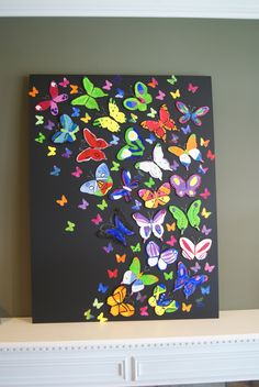 5th grade butterfies - art auction project (2013).  Butterfly shapes given to students. They painted their design and all butterflies were layed out to look as though flying through the air.