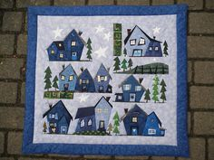 A paper-pieced town - cute! There's a link within the page to the Sulky website with free downloads of all the houses & trees.