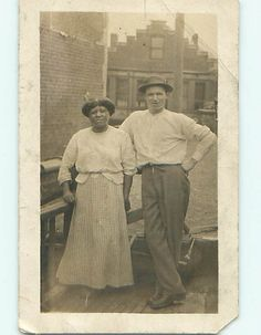 C1910 Interracial Couple.  He looks proud.  She looks bored.