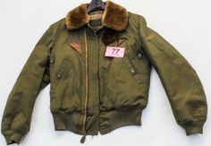 "Lot 77 in the 6.3.14 online & live auction! Fantastic vintage Army / Air Force flight / bomber jacket manufactured by Metro Sportswear, Inc. The green jacket features a cotton exterior, faux fur collar, wool lining, zippered front, two snap close front pockets, two leather accent pieces just below each side of the collar. Label of jacket reads, ""Jacket - Intermediate - Flying; Type B-5A; Spec No. 3220-A; Size 38; Stock No. 8300-470732; Property, U.S.Army, Air Forces"". #POGAuctions"