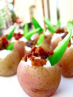 Red potatoes with sour cream, chivesy, and bacon, served as an hors doeuvre