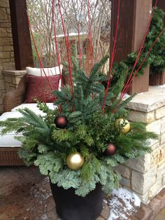 Outdoor winter urn arrangement - variety of greens, red twig dogwood, gold & brown outdoor ornaments, blending with house decor