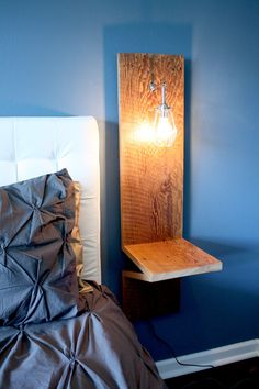 Bedside table lookbook on pinterest bedside tables side for Wall mounted nightstand diy
